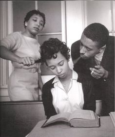 Young girl in a school for black civil rights activists in 1960 being trained to not react to smoke blown in her face.