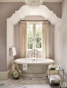 The master bath of an Atlanta residence by Suzanne Kasler and William T. Baker is painted in Benjamin Moore's Violet Pearl, and features Waterworks tub fittings.Pin it.