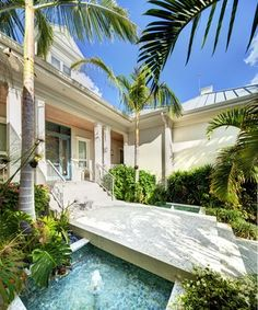 water feature under walkway + palms