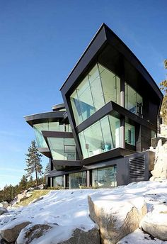 Curved Cliff House made of metal and glass.  Just right for living on the edge.