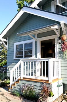 Simple front porch with overhang.