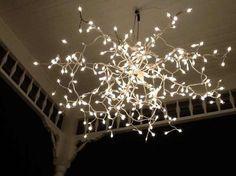 umbrellas, spray, white lights, christmas lights, white christmas, umbrella frame, back porches, patio tables, parti