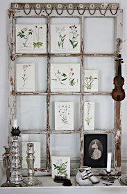 Pretty display using a salvaged window as a backdrop.