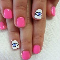 Think you can't make these eyes? Just layer drops of polish on top of one another for the pupils, then doodle with a nail art pen for the eye shape. #nailart
