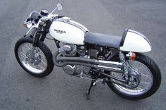'68 Honda CL350. This thing looks brand new! I love the checkered stripe.