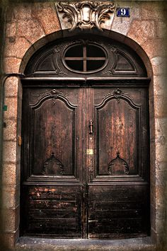 I LOVE doors that boast character! These are stunning!  Architecture / Rennes, Brittany, France--Declan O