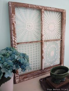 re-purposed vintage doilies in a window frame - now this would be cool with some of grandma's old doilies...