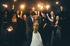 Christy and Fraser - Sparklers are such a testament to our innocence and inner child.  Making these photos is one of our favorite memories from the wedding; being outside with my closest friends and family members dancing around in the night with sparklers - that is a memory we will hold dear forever. - Toni Skotcher Photography