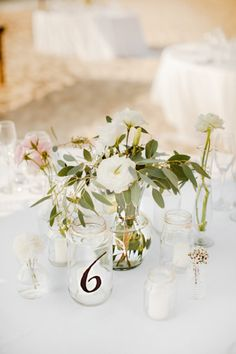 simple rustic #wedding flowers and mason jar table numbers