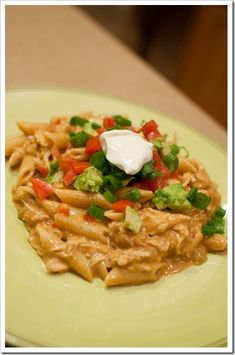 "CHICKEN ENCHILADA PASTA...You know, this would also be good mixed with good tortilla chips instead of pasta. Kind of like chilequiles (sometimes called ""mexican lasagna"")."