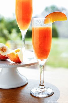 Frozen Peach Bellini Recipe | Unsophisticook.com -- this beautiful peach bellini recipe is the perfect fresh and fruity cocktail for sipping on a warm summer evening!