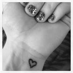 """(Past) heart tattoo....Love this! I wanna get three small hearts holding hands on my pinky finger or my wrist. My siblings and I used to draw cute little animated hearts of our family all the time. I want the words """"A cord of three is not easily broken"""" if it is on my wrist."""