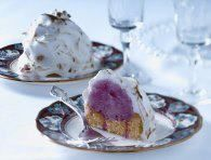 """Mini Baked Alaska (Tupperware Recipe)  6.5 oz.pkg. sponge cake dessert shells,  1 half gallon of ice cream (any flavor),  3 egg whites, 1/3 cup sugar.       Place one scoop of ice cream per shell on baking sheet, store in freezer until ready to assemble.    Meringue: place egg whites in the base of the Whip """"N Prep™ & whip the egg whites until foamy,  add the sugar a little at a time. Continue whipping until it is stiff & glossy."""