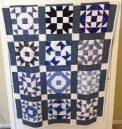 This is a Thangles quilt. I was sent a few strips of material and a pattern sheet, once a week until 12 were received. My good friend back east sent them. It was fun, watching the quilt top take shape after the weeks went on.