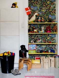 love the shelves with the wall paper