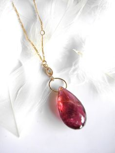 Pink Tourmaline and Diamond accented 14k Gold Pendant Necklace.