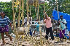 Fishermen Fishing - A group of fishermen work and hang around hand-made docks.