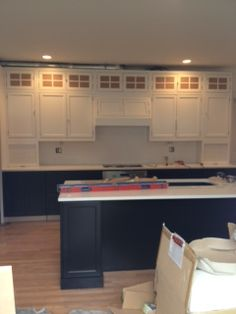 Dark lower cabinets, light upper cabinets