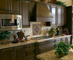 #Kitchen of the Day: Kitchen Backsplash Ideas - Materials, Designs, and Pictures. dark cabinet, kitchen idea, backsplash ideas, black cabinets, kitchen backsplash, kitchen countertop, kitchen remodel, kitchen tiles, kitchen cabinets