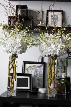 tall cylinder vases with white delphiniums (I think!) and twigs