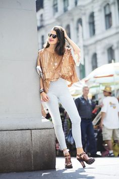 Leandra Medine in an Adidas by Stella McCartney top and Live the Process leggings—paired with heels.