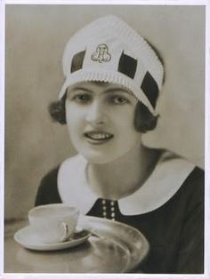 Nippy Waitress: 1925-33.  A young waitress employed by the catering firm J. Lyons who employed them in his Corner House teashops. Dressed in the uniform of a 'Nippy', a style introduced in 1925.  The nick-name 'Nippy' was given to waitresses in tea shops and restaurants owned by J. Lyons because they 'nipped' speedily in between tables when serving customers.