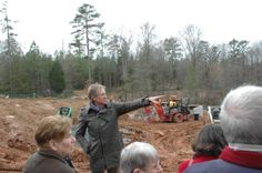 Designer W. Gary Smith gives a behind-the-scenes tour during the construction of Lost Hollow