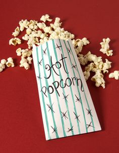 Handmade popcorn bags enhance a family movie night