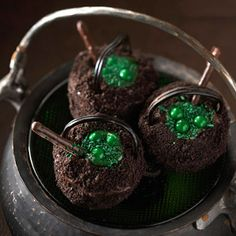 Cauldron Cupcakes -- Fill chocolate #cupcakes with vanilla pudding (dyed green) and top with green sprinkles to make these cute #Halloween cupcakes.