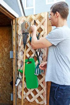 Screw a rectangular piece of lattice onto two 2x4s and attach to the back of a shed door. Use zip ties as loops for hanging rakes, shovels, and other garden gear. | Photo: Laura Moss