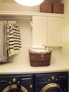 small laundry room organization: cabinet, shelf, countertop, and rod (Mini Manor Blog)