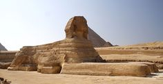 In this photo the restoration block-work on the body of the sphinx can be seen clearly, in multiple layers, revealing beneath it a very weathered original stone. Concrete has been used to fill in the headdress as well as deep rivets in the body. Horizontal signs of weathering can be seen on the wall behind the sphinx that would have enclosed a lake. (photo copyright Marek Kocjan 2006)