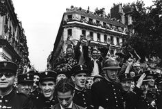 """Paris 1944. """"Champs Elysees on the 26th August to celebrate the liberation of Paris""""  Robert Capa"""
