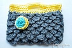 Try your hand at this Crocodile Clutch Purse to sport around town. The half double crochet stitch is worked to get this cute design and the flower embellishment gives it the perfect finishing touch.