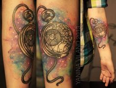 Doctor who pocket watch circular gallifreyan tattoo with watercolor galaxy background