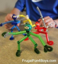 pipe cleaners / straws + bead for head