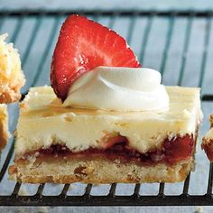 Strawberry-Lemon Shortbread Bars | These triple-layered treats, topped with fresh strawberries and whipped cream, elevate the classic lemon bar to ethereal heights. | #Recipes | SouthernLiving.com