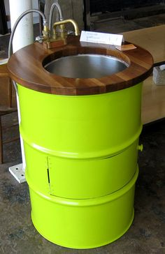 Old oil drum. New bathroom sink. Awesome lime / wood color combo!