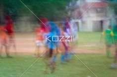 Indian Soccer Movement - Abstract lens motion-blurring of children playing a soccer game in Kochi, India.