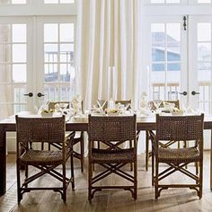 Coastal Living: Beachy dining room with rattan chairs, simple farmhouse table, rustic floors, french ...