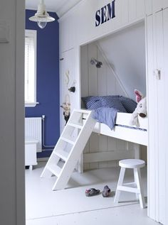 fun with white and blue and built in bed