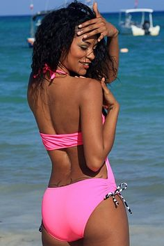 Hot pink one piece bathing suit with zebra slide side ties.