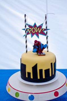 Awesome in it's simplicity. Spiderman candle. Party kids got simple, colorful cupcakes with stick toppers - see site.