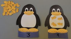 Print off penguins or cut them out from construction paper. Add numbers. Encourage children to place the correct number of fish crackers onto the penguins. Fun preschool counting idea or a math game for your penguin or Arctic unit.
