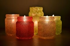 Handmade Christmas decorations. Baby food jars with glue and glitter.