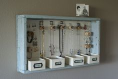 old drawer, wooden thread beads, and little boxes make a creative & artful way to hang/put jewelry