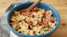 Give your pasta salad the pizza treatment with this party-ready recipe that's packed full of fresh vegetables, cheese and pepperoni.