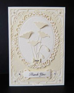 "By Sandma. Memory Box ""Prim Poppy"" and ""Tiny Bow"" dies mounted on Spellbinders ""Decorative Oval"" and ""Elegant Labels Four"" dies."