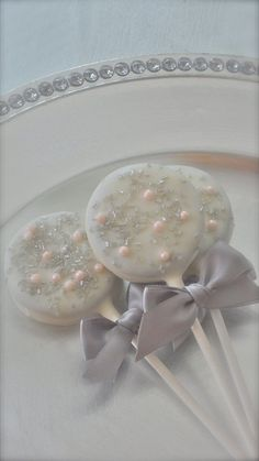Edible Wedding Favors Silver and Pink Chocolate Dipped Oreos Frost The Cake. $18.00, via Etsy.