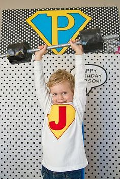 Cute photo prop for superhero party, the blog has other cute ideas like paining and turning a refrigerator box into a telephone booth...possibly for Superman to change in.